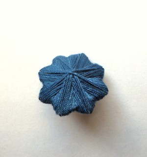 The completed Eight-Pointed Star Thread Button
