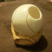 A ceramic baseball and glove figurine.