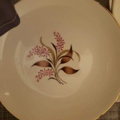 A china plate with a decorative pattern in the middle.