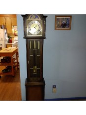 A wooden grandfather clock in a home.