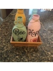 The completed bottle decor on a granite countertop.