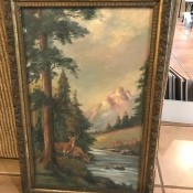 A landscape painting with trees, mountains and deer.