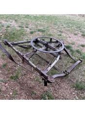 A metal item on a grassy field.
