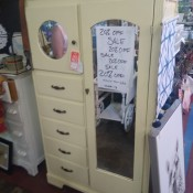 A vintage chifferobe with mirrors.