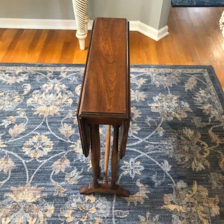 A wooden drop table with the sides down.