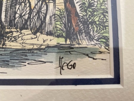 A close up of the signature of a watercolor painting of Key West.