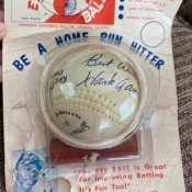 A baseball toy with Hank Aaron's signature.