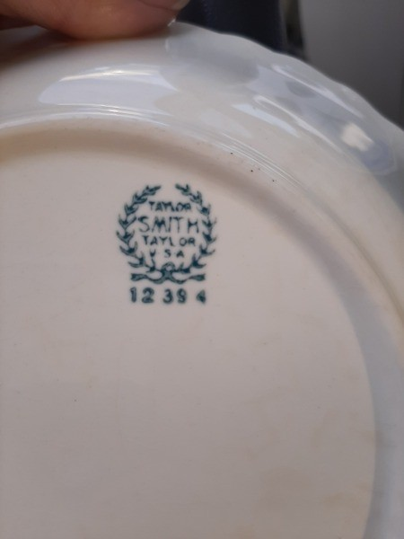 The marking on the bottom of a set of china.