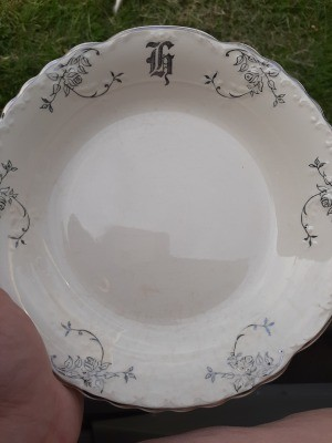 A china plate with a monogram.