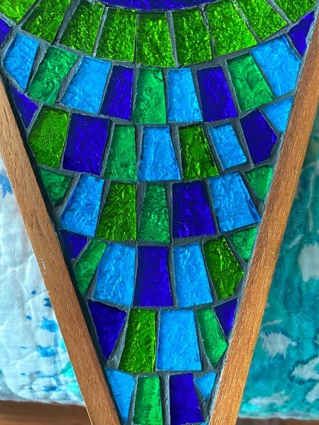 A close up of a stained glass clock.