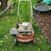 A lawnmower in a yard.