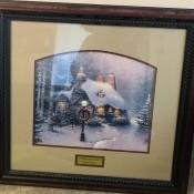 A photo of a framed Stonehearth Hutch by Thomas Kinkade?