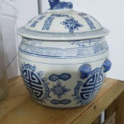 A small china pot with a lid.