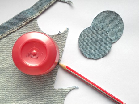 Cutting out circles of recycled jeans.