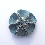 The completed beaded flower brooch.