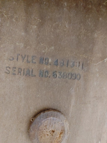 The serial number on the bottom of the cedar chest.