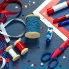 A collection of craft supplies for making patriotic decorations.