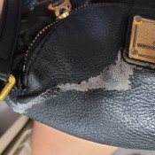 A bleach stain on a leather purse.