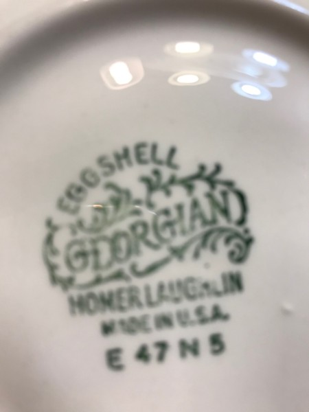 The marking on the back of a set of china.