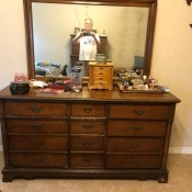 A wooden dresser with mirror.