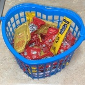 A basket of fast food condiment packets.