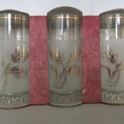 Three decorative glasses in a cardboard package.