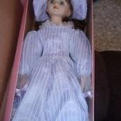 A porcelain doll, still in the original box.