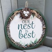 The completed Our Nest is Best Pizza Pan Craft