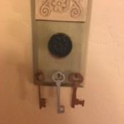 Skeleton keys hanging from a plaque.