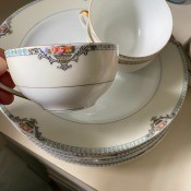 A china cup with a decorative rim.