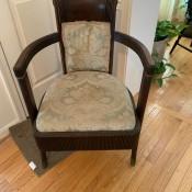 An antique wooden barrel chair.