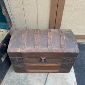 An old wooden steamer trunk.