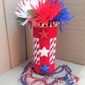 The completed decorative vase with flowers.