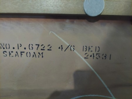 The markings on the back of a bedroom set.