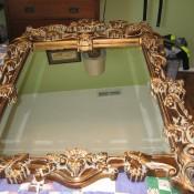 A decorative Bassett mirror.