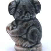 A small figurine of a koala.