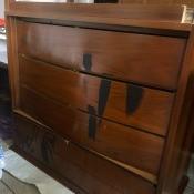 An antique dresser stored upside down.