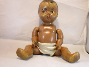A baby doll wearing a diaper.