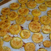 The baked squash rounds on a cookie sheet.