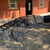 An antique piece of farm equipment.