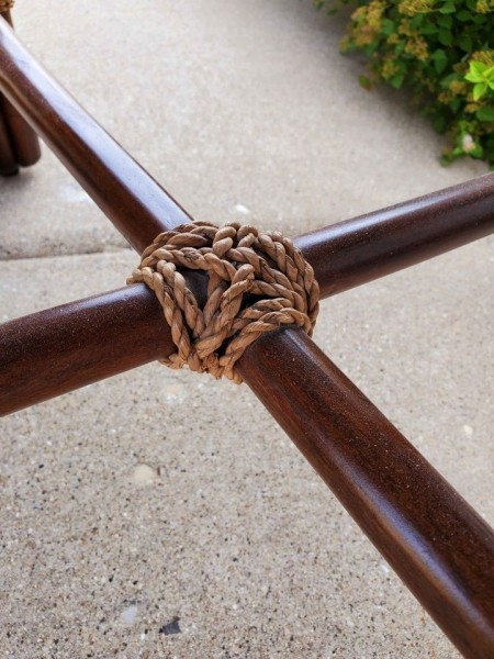 Rope holding the crossbeam in place.