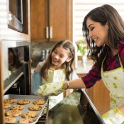 A mom and daughter making cookies.
