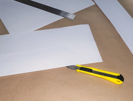 Cutting paper into strips.