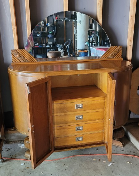The open front doors of the buffet table, exposing the drawers inside.