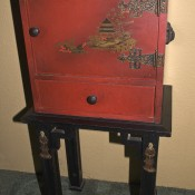 An old red colored humidor.