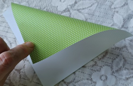 Folding a piece of origami paper.
