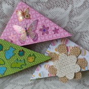 Three differently decorated bookmarks.