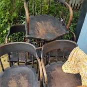 A collection of wooden dining chairs.