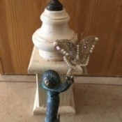 Adding a faucet and handle and decorations to the birdhouse.