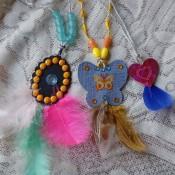 Three decorative feather pendants.